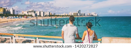 Miami beach people lifestyle young tourists couple walking in South Beach, Miami, Florida. USA travel. Panoramic banner background. #1420272827