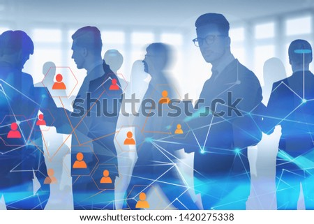 Business people walking and discussing documents in blurred office with double exposure of social media icons and network hologram. Concept of HR and hi tech. Toned image #1420275338