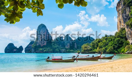 Amazing view of beautiful Ao Nang Beach with longtale boats. Location:  Krabi Province, Thailand, Andaman Sea. Artistic picture. Beauty world. #1420296461