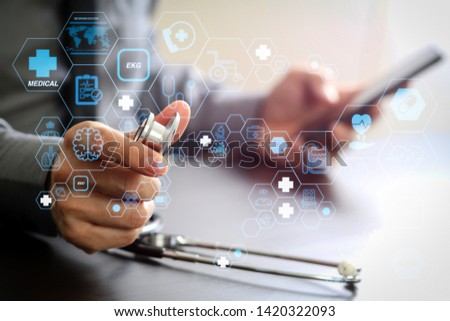 Health care and medical technology services concept with flat line AR interface.smart medical doctor working with stethoscope and mobile phone on dark wooden desk in modern hospital  #1420322093