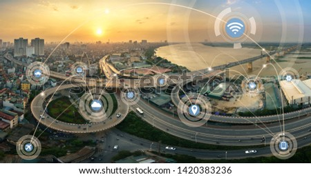 Smart city and wireless communication network concept. Digital network connection lines of Hanoi city at Vinh Tuy bridge #1420383236