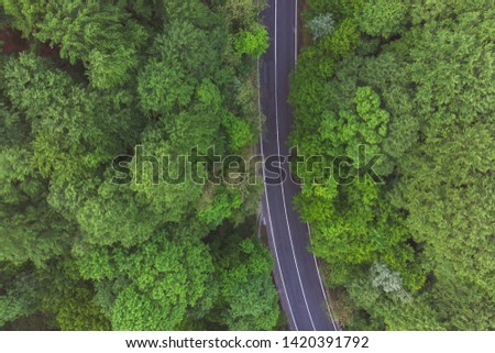 Aerial view of a beautiful mountain road, at sunrise #1420391792