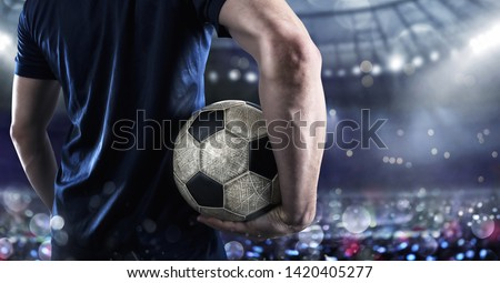 Soccer player ready to play with soccerball at the stadium #1420405277