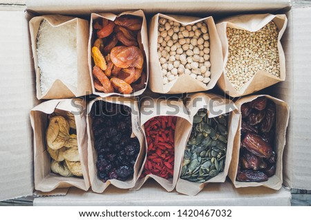 Zero waste delivery concept. Eco-friendly packing. Paper bags with organic food, zero waste shopping, sustainable living, plasticfree. Top view. #1420467032