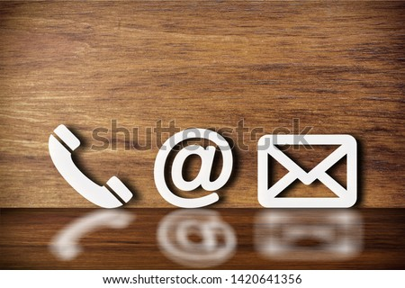 Close-up Of Various White Contact Options Leaning On Wooden Wall          - Image #1420641356