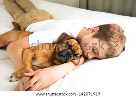 Young Boy Fell asleep Hugging his Dog #142071919