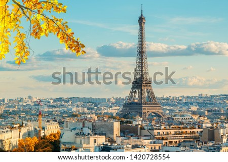 Eiffel Tower iconic landmark and Paris old roofs, Paris France at fall #1420728554