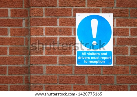 Visitors and drivers report to office reception sign