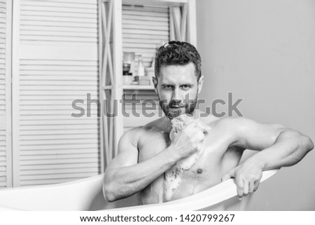 Man bearded hipster use sponge cleaning skin. Personal hygiene. Take care hygiene. Personal grooming is cleaning parts body. Hygiene concept. Bath have greater effect mood than physical exercise. #1420799267