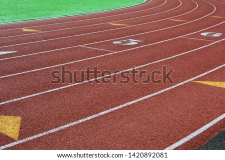 Running Track Around a Football Field #1420892081