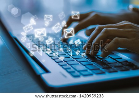 Young businesswoman hand using laptop with email icon, Email concept #1420959233