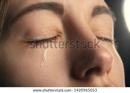 sad sad woman crying, closed eyes, closeup portrait #1420965053