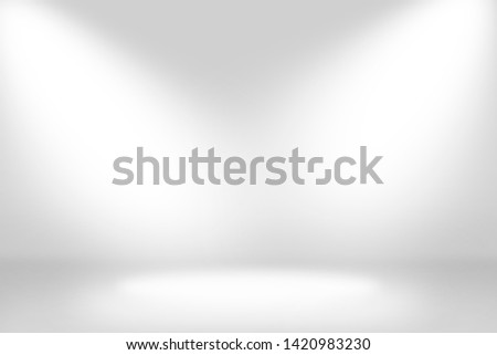 Abstract studio background gradient silver gray wall in empty room template with bright clear light from spotlight, can use for interior background and your products display