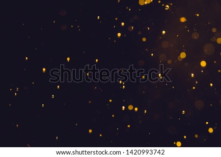 Dark Abstract Gold bokeh sparkle on black background #1420993742