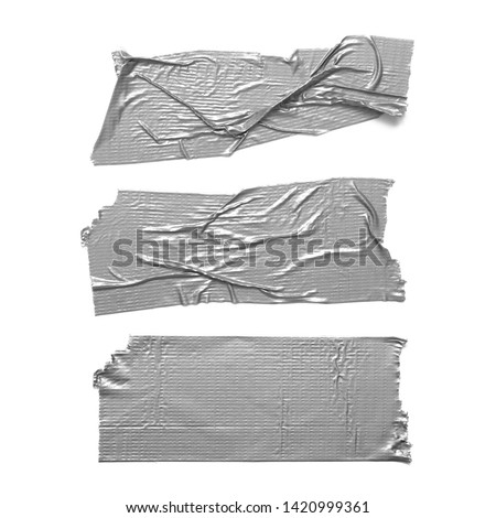 Duct tape pieces isolated on white background. Set of torn wrinkled silver grey adhesive tapes. #1420999361