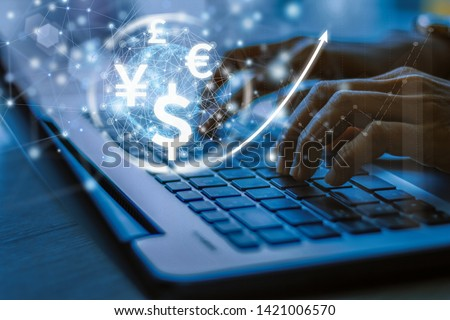 businesswoman uses laptop computer, world currencies, wallet cryptocurrency on virtual screen, fintech financial technology, internet payment, money exchange, digital banking concept Royalty-Free Stock Photo #1421006570
