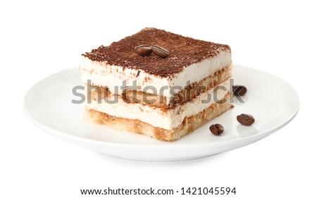 Plate of tiramisu cake isolated on white Royalty-Free Stock Photo #1421045594