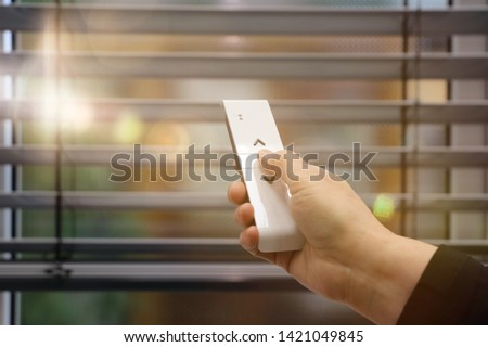 Venetian blind with remote control Royalty-Free Stock Photo #1421049845