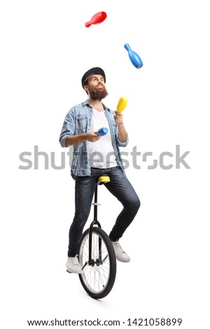Full length shot of a bearded man on a unicycle juggling with clubs isolated on white background #1421058899
