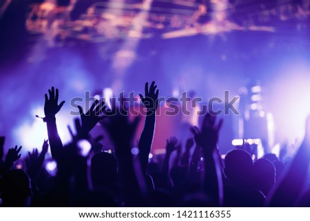 Cheering crowd with hands in air at music festival #1421116355