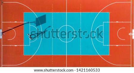 Man Play Basketball, Creative Aerial Top Down Drone View. Colorful Abstract Minimal Art Royalty-Free Stock Photo #1421160533