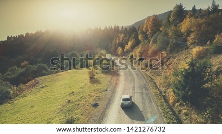 Mountain Hill Country Road Car Drive Aerial View. Roadside Automobile Highland Scenery Landscape Overview. Dense Green Forest Unpolluted Natural Environment Concept. Drone Flight Royalty-Free Stock Photo #1421276732