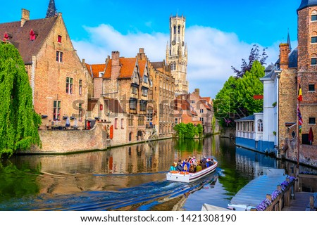 Classic view of the historic city center with canal in Brugge (Bruges), West Flanders province, Belgium. Cityscape of Bruges. #1421308190