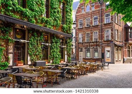 Old street of the historic city center of Antwerpen (Antwerp), Belgium. Cozy cityscape of Antwerp. Architecture and landmark of Antwerpen #1421310338