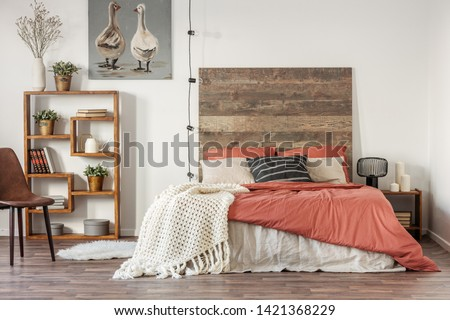 Beautiful bedroom interior with king size bed wooden headboard #1421368229