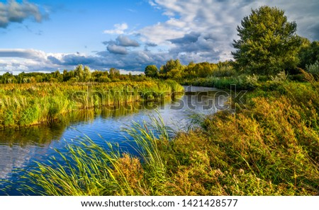 Rural nature river sky clouds landscape. Nature river shore. Country river landscape. River sky clouds #1421428577