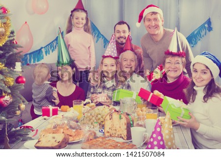 Large family happy to see each other during the Christmas dinner #1421507084