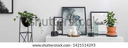 Panorama of home interior with white sideboard and flower stand