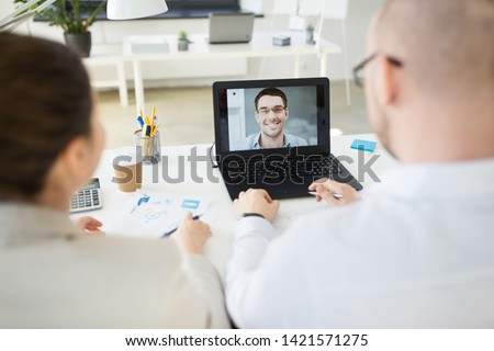 business, employment and technology concept - team of employers having video conference or job interview with new employee at office #1421571275