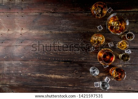 Assortment various hard and strong alcoholic drinks in different glasses: vodka, cognac, tequila, brandy and whiskey, grappa, liqueur, vermouth, tincture, rum, etc. Wooden background copy space #1421597531