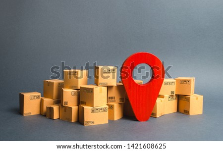 Lots of cardboard boxes and a red position pin. Locating packages and goods. Algorithm for constructing a minimum route for the delivery of orders. Logistics transportation, storage warehouse. Royalty-Free Stock Photo #1421608625