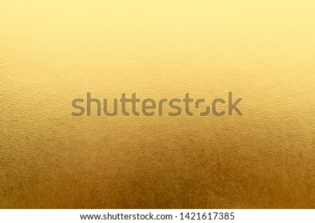 Shiny yellow metallic gold leaf foil texture background #1421617385