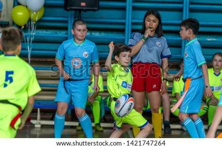 ODESSA, UKRAINE - MAY 18, 2019: Young children play rugby during final games of championship in hall. Children's sport. Children play rugby 5. Fight for victory of children in rugby #1421747264
