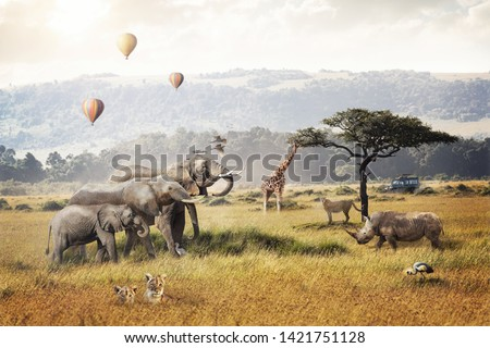 Kenya Africa safari dream trip scene with wildlife animals together in a grassland field with hot air balloons and game drive tourist vehicle. #1421751128