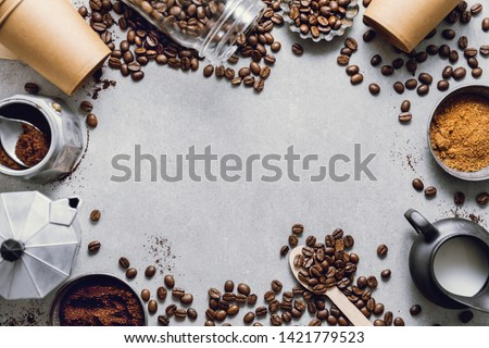Ingredients for making moka coffee. Moka pot with coffee beans and ingredients on grey background. Coffee making concept. Flat Lay #1421779523