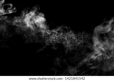 Abstract powder or smoke effect isolated on black background #1421841542