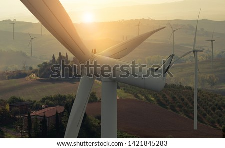 Wind turbine farm power generator in beautiful nature landscape for production of renewable green energy is friendly industry to environment. Concept of sustainable development technology. #1421845283