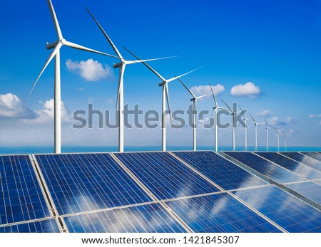Solar energy panel photovoltaic cell and wind turbine farm power generator in nature landscape for production of renewable green energy is friendly industry. Clean sustainable development concept. #1421845307