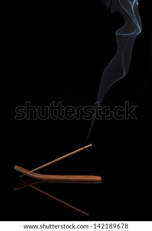 Aroma stick with smoke on black background #142189678