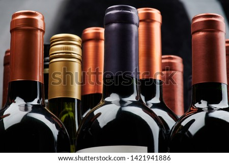 Different wine bottles close up view of stack #1421941886
