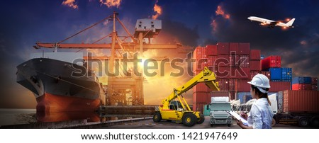 Asian female dock worker control loading Containers box to truck for Logistic Import Export Background, Business logistic concept, import and export cargo concept  #1421947649