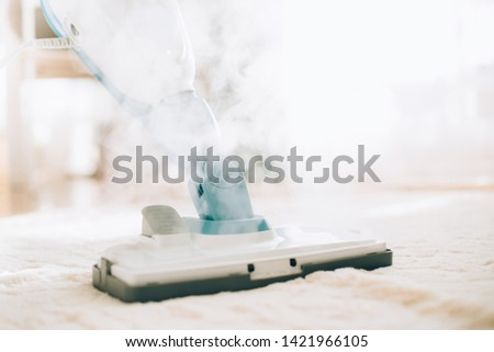 Cleaning the floor with steam cleaner. Banner and copy space. Cleaning service concept. Royalty-Free Stock Photo #1421966105
