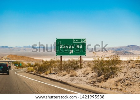 Zzyzx Rd sign on Interstate 15 freeway from Los Angeles to Las Vegas #1421995538