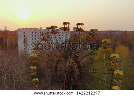 Views of city of Pripyat near Chernobyl nuclear power plant, aerial view. Ferris wheel in City of Pripyat at sunset time. Apocalyptic city of Pripyat after a nuclear explosion at a nuclear power plant #1422212297