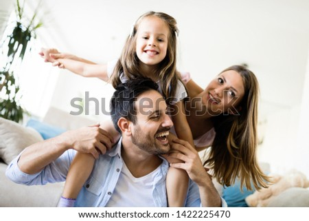 Happy family having fun time at home #1422225470