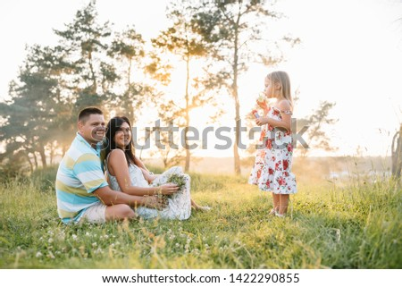 happy family concept - father, mother and child daughter having fun and playing in nature. #1422290855
